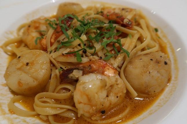 Satisfying Seared Scallop & prawn pasta ($26)