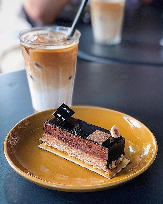 [Telok Ayer] The Yatsura ($8.50) sees a hazelnutdacquoise layered with dark chocolate mousse and a crunchy hazelnutfeuilletine, glazed with a glossy chocolate ganache.