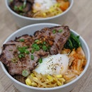 Striploin Bap from @twohanasg  rice topped with striploin slices, kimchi, namul, caramelised onions and a 63-degree-egg to bind it all together and bring all goodness in one bowl.