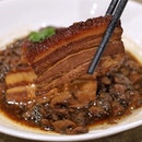 """Stewed Pork Belly with preserved """" Mei Cai """" vegetables in claypot from Nan Bei @imperialtreasuresg At Ngee Ann."""