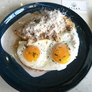 Atlas Coffeehouse having Creamy Mushroom Toast with Sunny Side Up.