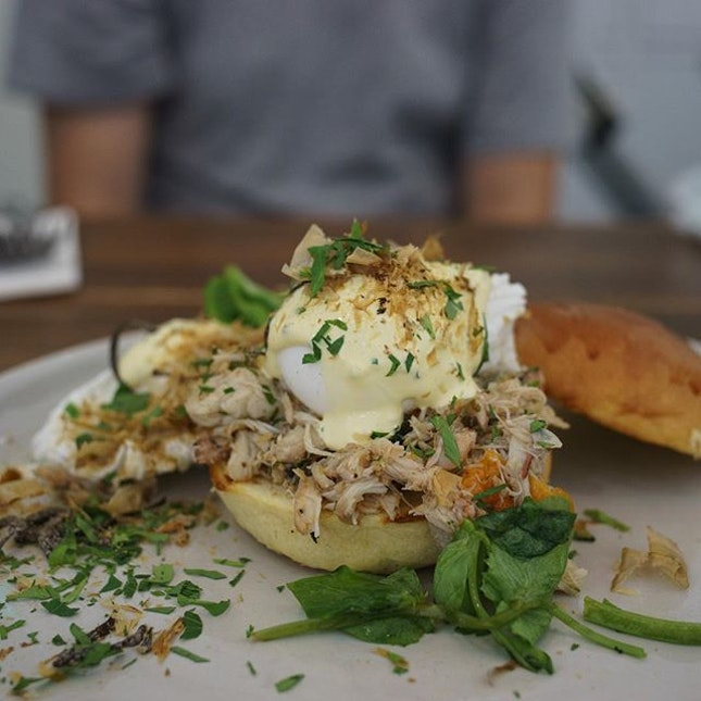 Crab Benedict | marinated crab rump, avocado, semi-dried tomato, coriander, greens, free-range poached egg, toasted brioche bun topped with chive hollandaise & bonito flakes