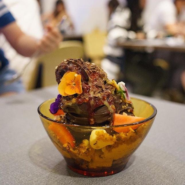 Dark Chocolate Sundae | Dark chocolate sundae, passionfruit curd, raspberry purée, hazelnut crumb, honeycomb, chocolate crumb, whipped cream