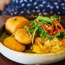 Chilli Scrambled Eggs with Fresh Crab | Chilli scrambled eggs, fresh crab, creamy corn potato cake, rocket, crispy mantou