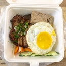 Broken Rice With Pork Chop And Ham ($9.90)
