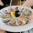 A dozen fresh oysters ($12)  Yeah you read that right.