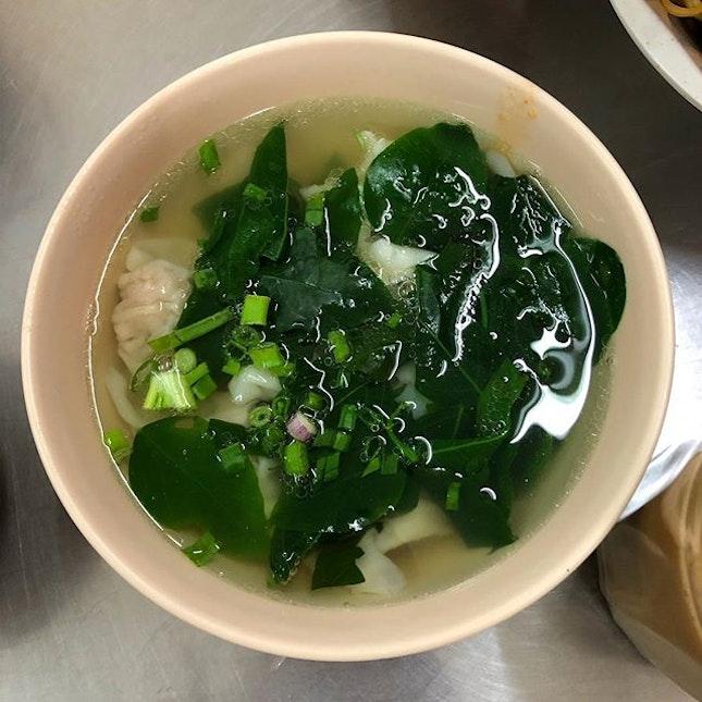 Dumpling soup with loads of greens.