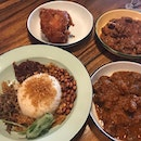 We loved the nasi lemak and rendang beef at @villagenasilemak at #rafflesplace The sauce is spicy without being overbearing and the beef is tender.