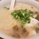 Le nu pork broth noodles with garoupa fillet.