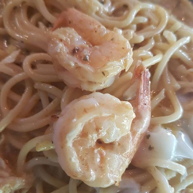 Seafood laksa paste spaghetti with an added side of grilled barramundi.