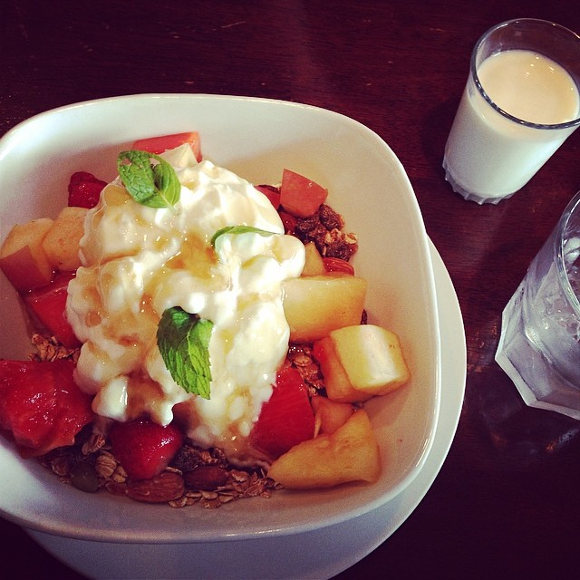 Muesli fruit salad with yoghurt and a drizzle of honey and low fat milk.