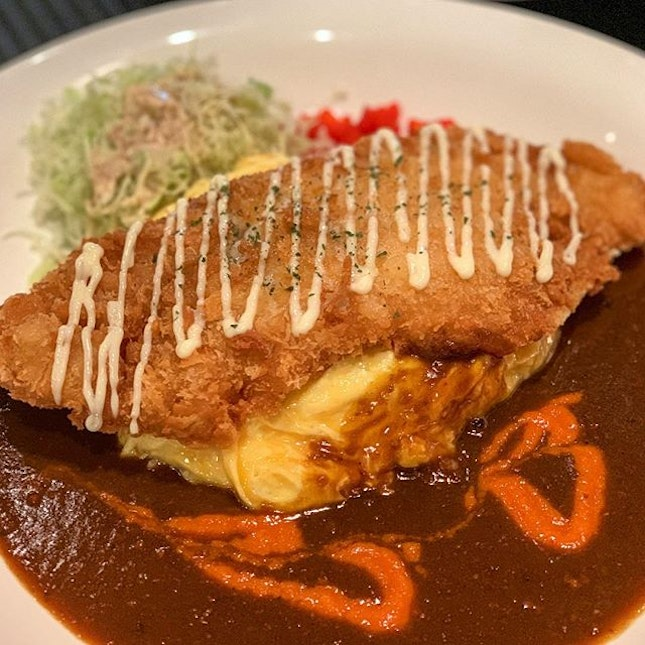 Huge fried fish fillet with omelette rice with level 2 Japanese curry.