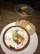 eggs & tomato relish ($15), grilled salmon pasta ($17)