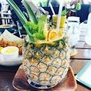 IDEA: drink out of a pineapple and take a four day weekend #tanjongbeachclub #tanjongbeacb #tbcsentosa #tbcsg #block80 #burpple