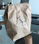 This doggy bag, it has my name on it - This doggy bag, it had 3 freshly baked bagels in it.