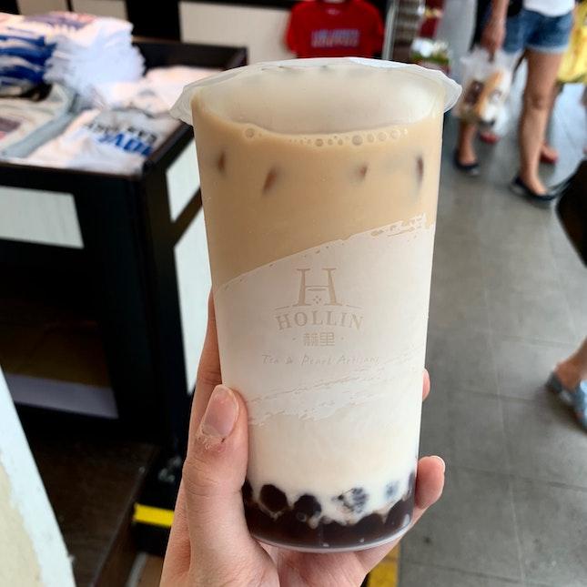 black tea latte with cocoa pearls