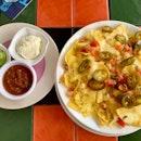 cheese nachos + salsa, sour cream & guac!