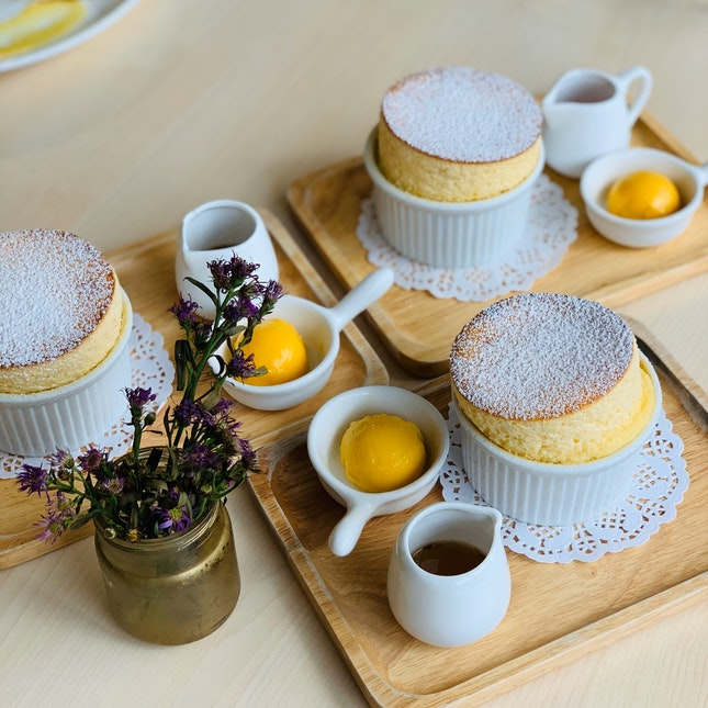Vanilla Soufflé With Osmanthus Maple Syrup And Mango Sorbet.