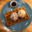 freshly baked waffle with 2 scoops of ice cream