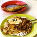 Hainanese Curry Rice with baby cuttlefish, runny egg and Assam fish tail  _ Messiness at its best.