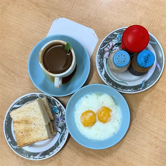 Traditional breakfast of butter toast and soft boiled eggs.