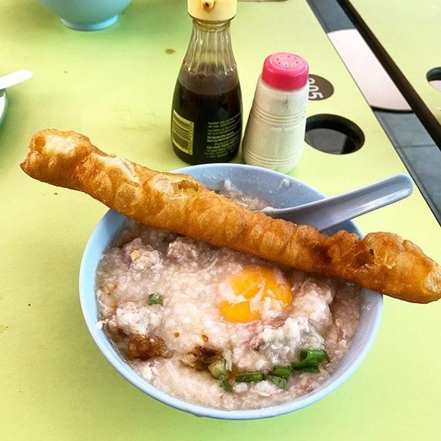 Hainanese Porridge with Minced Pork, Liver,  Raw Egg, Fried Fritters  _ Warm porridge on a gloomy morning.