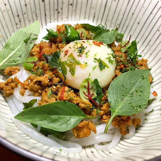 Krapow Bee Tai Mak _ Relish's Thai inspired bowl of Basil minced chicken, short rice noodles topped with a wobbly egg.