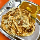 Roti Prata  _ Crispy prata should accompanied by a robust curry.