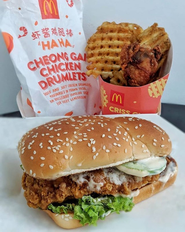 Launching today, is the HA HA CHEONG GAI burger and drumlets at all @mcdsg outlets and on @grabfoodsg!