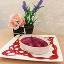 Gobi Dessert's signature Poire William – pear soaked in red dragonfruit fruit enzyme and baked with crème brulee.