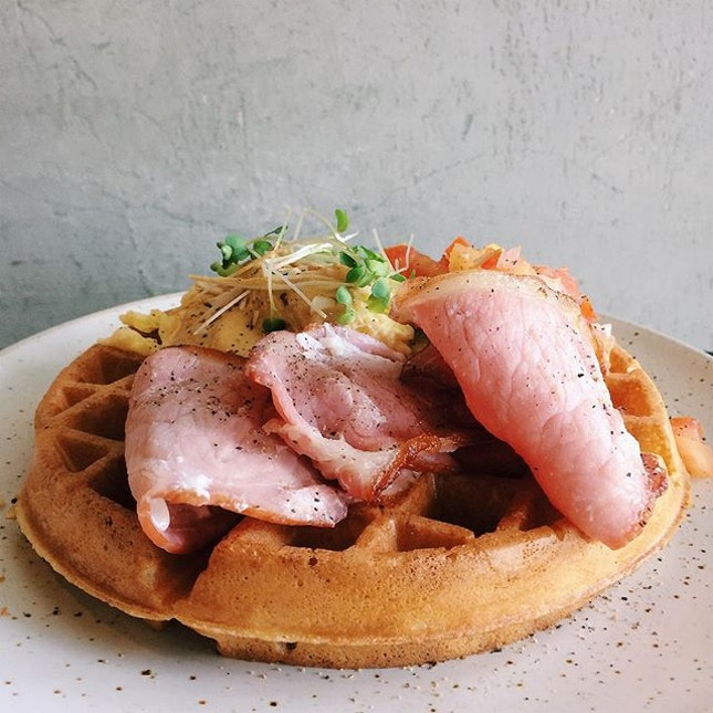 Savoury waffle with grilled streaky bacon and scrambled egg with Craftsmen sauce from Craftsmen Specialty Coffee.