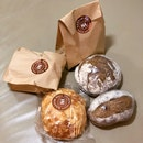 Almond Brioche, Cranberry Walnut Sourdough, Rye Sourdough, Chocolate Milk Loaf (in Bag)