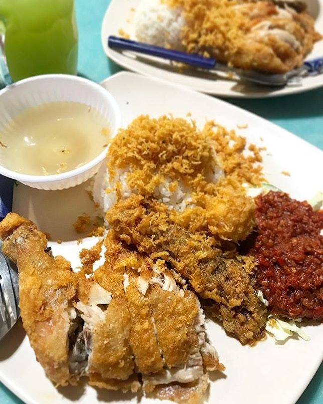 Nasi Ayam Penyat [Smashed Fried Chicken with Rice] ($5) .