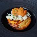 Sea urchin on a flaky and crisp crab custard tart