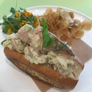 Lobster Roll - tomato, celery, chives, aioli, potato chips [$34]