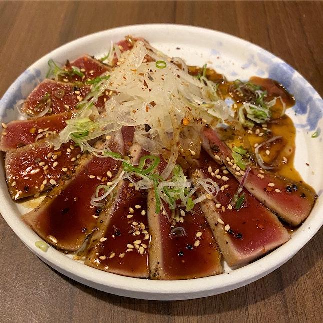 Ahi tuna tataki - Yellowfin tuna with onion silvers & Wasabi yuzu vinaigrette [$18.80]