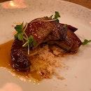 Pan-Seared Foie Gras, Warm Blinis, Caramelized White Peach & Mesclun Greens [$34]