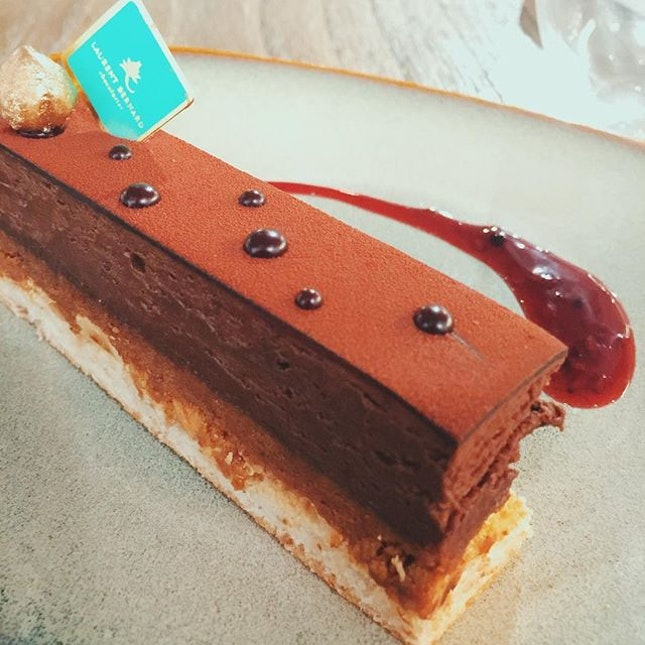 Trianon ($10.37)  Is a hazelnut biscuit base with chocolate cream.