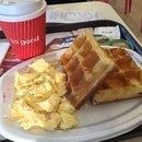 Waffles with scrambled eggs.
