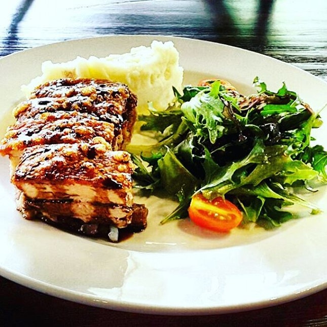 12 hours belly of pork Crispy-skin belly of pork served with creamy mashed potatoes, mesclun salad & honey-balsamic reduction  The interweaving layers of crispy brown skin and luscious meat crumbles to a shattering crisp in your mouth.