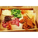 Laffio's Big Brunch  Freshly baked toast served with smoked salmon, beef fillet, bacon, scrambled eggs, mesclun & waffle fries  This feels like a wooden tray that students used to carry in a canteen to have their food being served on it.