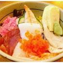 Sakura Chirashi Don  Assorted Seafood on Sushi Rice  Salmon, maguro, squid, marinated shiitake mushrooms, prawn, yellowtail and salmon roe.