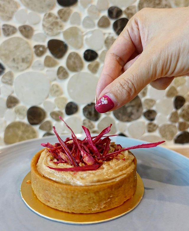 Revel in the Rojak Banana Tart @thegaragesbg  For those wondering how is rojak part of the tart itself, the pinkish red strips on top are actually made from rojak flowers.