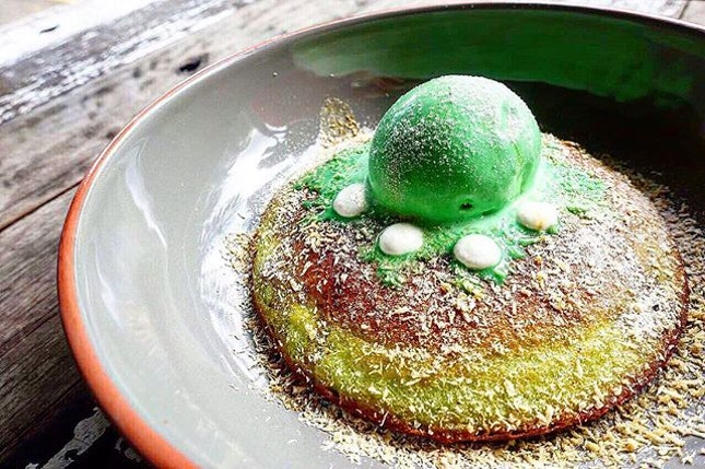 Relish the local flavour of the Ondeh Ondeh Hotcake @artistrycafesg  Pandan hotcake topped with lime green pandan coconut gelato and drenched in syrupy gula melaka.