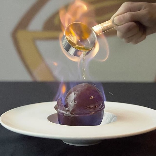 Chocolate Ball 19.90RM  Chocolate ball encompassing a scoop of smooth vanilla ice cream, lit up with alcohol.