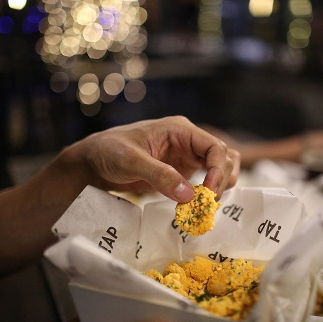 Salted Egg Shrimp Poppers $12 Easy to eat battered and deep fried shrimps, tossed with salted egg, curry leaves and spices.