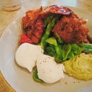 Corn Fritters ($23) Poached Egg, Bacon, Grilled Tomato, Guacamole, Asparagus, Spinach