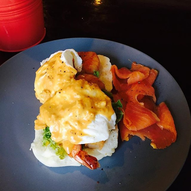 Creamy salted York egg Benedict with grilled prawns and smoked salmon.