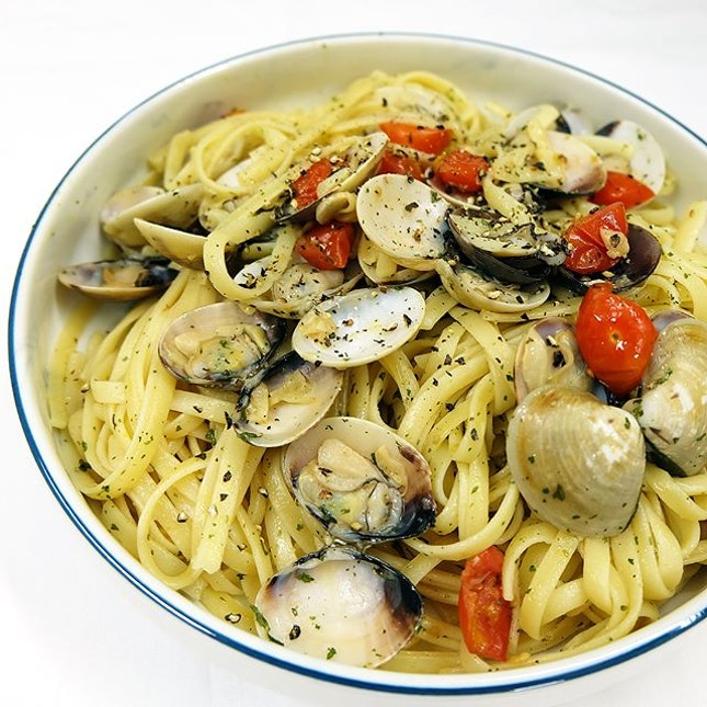 Spaghetti Aglio Olio with Clams and Cherry Tomatoes.