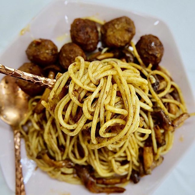 Spaghetti with mushrooms and meatballs tossed in Balsamic Vinegar.